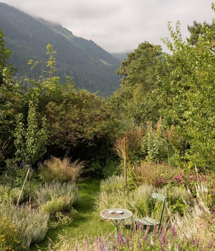 A wild garden in the chalet's grounds created by Harumi's partner, photographer Benoît Peverelli