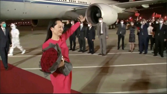 Supporters of Huawei's Meng Wanzhou gather at Shenzhen International Airport on her return after almost three years in exile