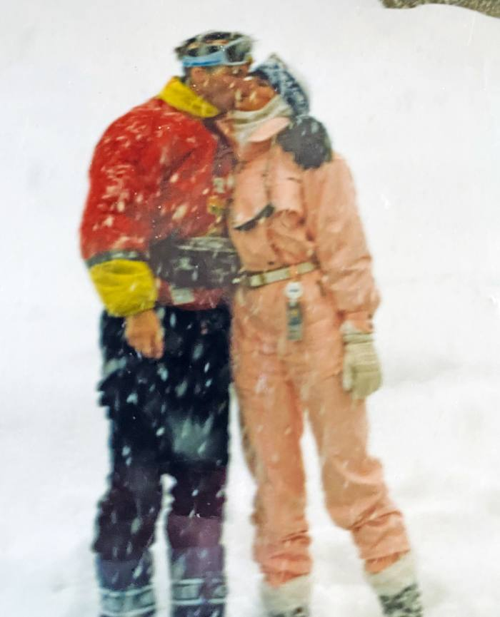 Ducas's lifelong love of skiing – seen here with her husband, John, in 1992 – is represented by a gondola charm