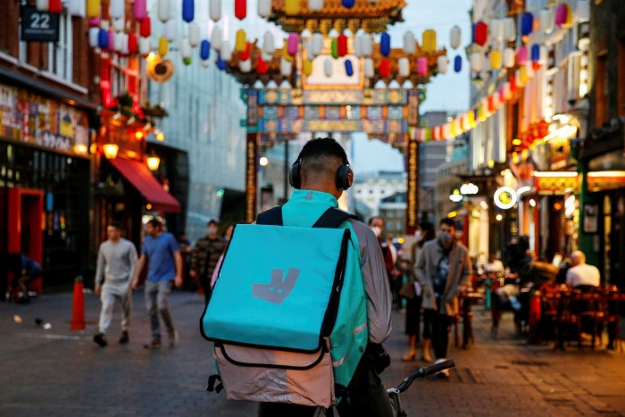 A Deliveroo courier in London's Chinatown
