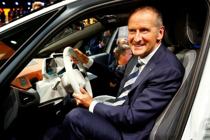 Herbert Dice, chief executive of carmaker Volkswagen, poses in a car