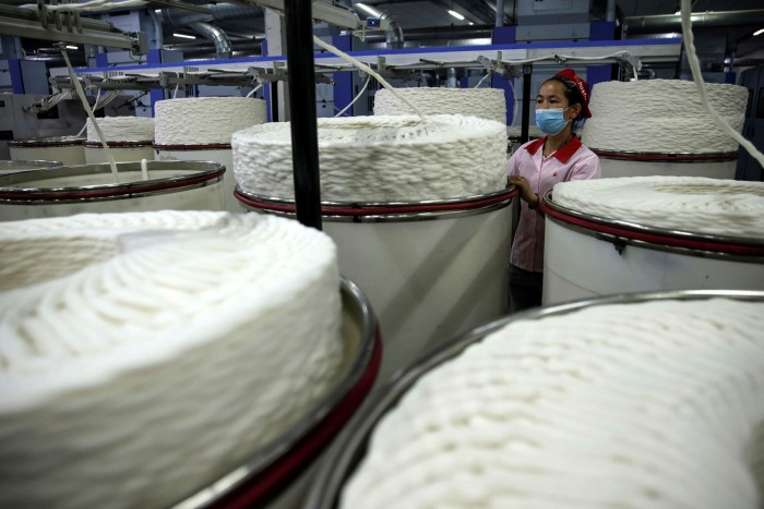 A worker operates cotton yarn machinery at the Aksu Huafu textile company in western China's Xinjiang autonomous region. Inditex says it has 'zero tolerance for all forms of forced labour'