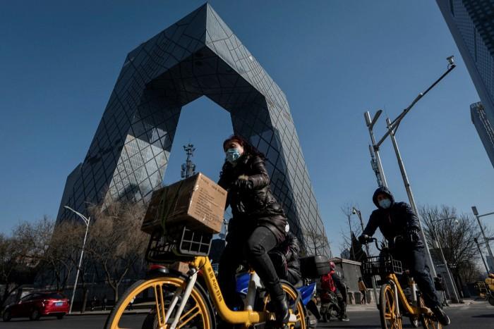 A cyclist passes CGTN's Beijing headquarters