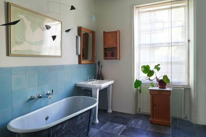 Alexander Calder-esque mobile above the bath in an Islington house by Rachel Chudleyl