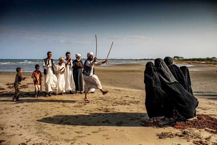 A traditional Rashaida dance performed with swords on a beach on the Red Sea coast