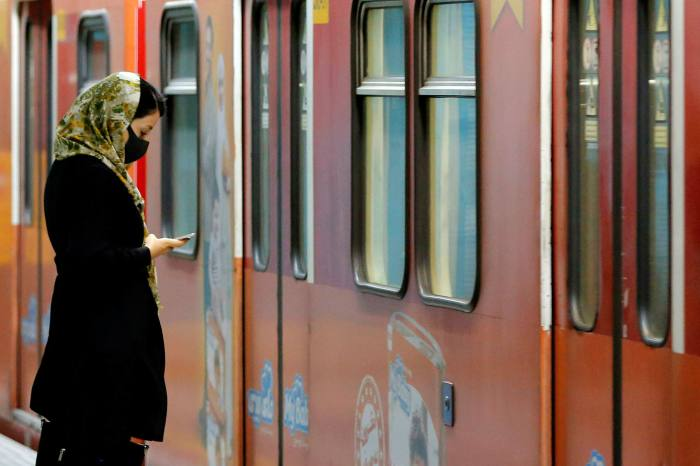 A woman waits for a train at Tehran's metro. Iran is negotiating with China over the purchase of 630 carriages for the city's metro, according to comments made by Tehran's mayor