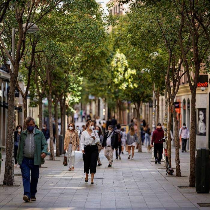 A shopping street in Madrid. Over the past week almost a quarter of the region's people tested for coronavirus have been positive