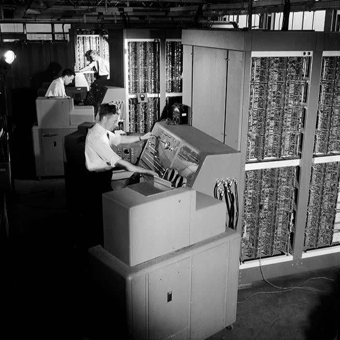 The Digital Electronic Universal Computing Engine, an early computer photographed in 1958, was developed from plans by Alan Turing, the pioneering British computer scientist