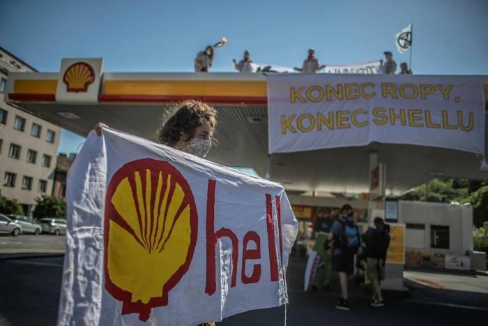 Climate activists protest against Shell in Prague, Czech Republic. Oil majors have reduced the value of their assets by tens of billions of dollars as they re-evaluate long-term oil prices