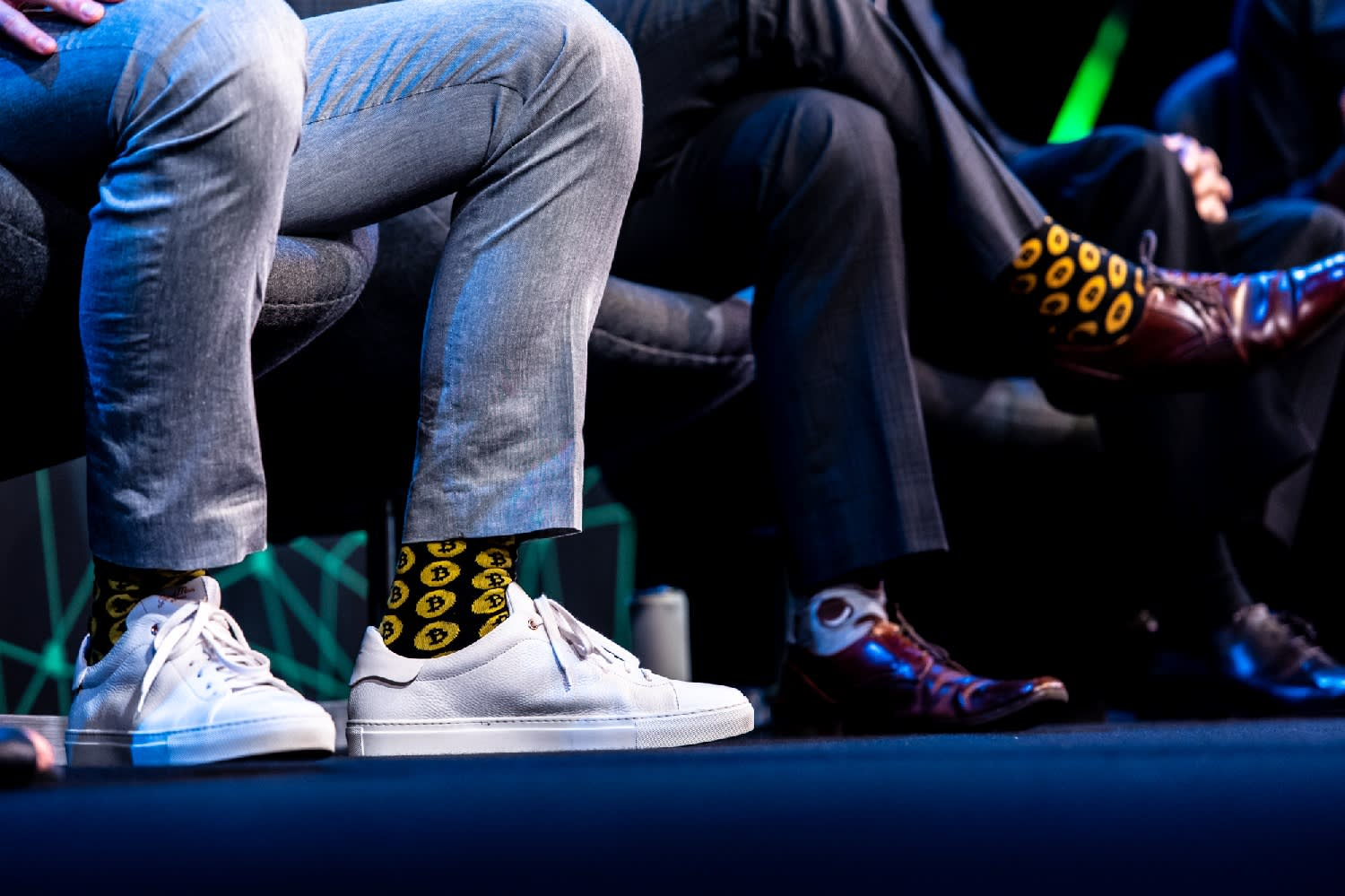 Bitcoin socks worn by panelists at the 2019 CryptoCompare conference