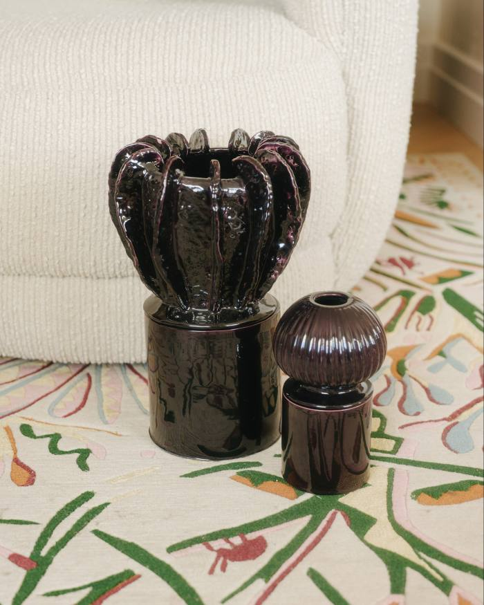 A pair of ceramic candlesticks, edited by Atelier John Roger Paris