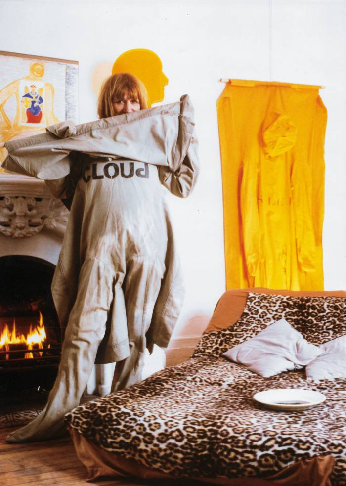 Nicola L at her home in the Chelsea Hotel, wearing one of her series of Pénetrables, 1989