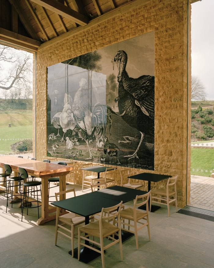 """The Kitchen at the Farmyard, which offers all-day dining. The feature wall tiles are created from a 17th-century lithograph called """"Turkeys & Fowls"""""""