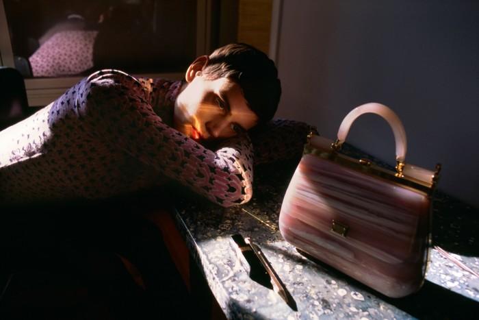 Miu Miu chenilletop, £570. Dolce & Gabbana Plexiglas crossbody Sicily bag, £3,421. Ontable: Chanel Rouge CocoFlash lipstick in 144 Move, £33. Kaweco aluminium Gold ALSport mechanical pencil, £80,at Choosing Keeping
