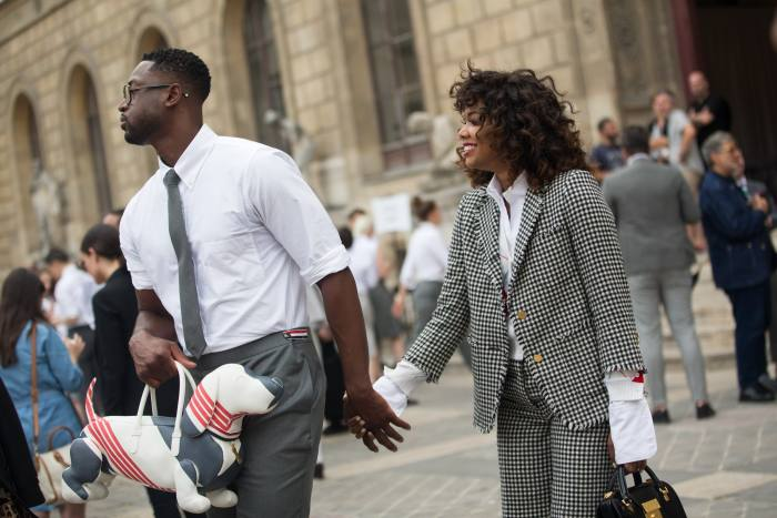 Dwyane Wade and Gabrielle Union outside the 2017 Thom Browne show, Paris
