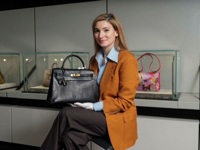 Rachel Koffsky, senior specialist in handbags and accessories at Christie's, with a 1994 Hermès Kelly bag, photographed for the FT by Harry Mitchell