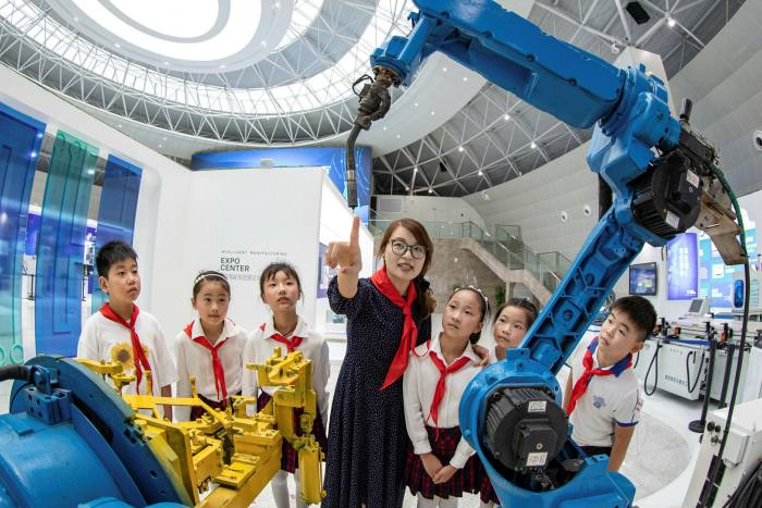 Chinese school children learn about artificial intelligence technology in Haian City. Some measure of global division is possible in semiconductors, AI and other areas where US-China rivalry is intense