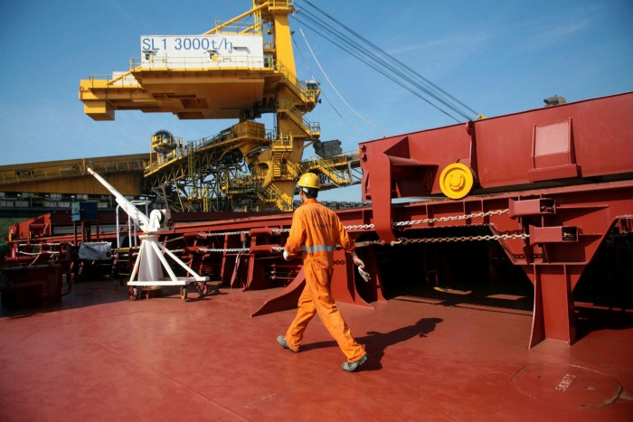 An employee prepares the 'Stella Pearl' cargo ship heading to China at the Tiplam terminal in Santos, Brazil