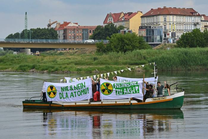 Members of the Brandenburg Green Youth and Polish Green MPs protest on the German-Polish border river Oder against Poland's plans for a new nuclear power plant
