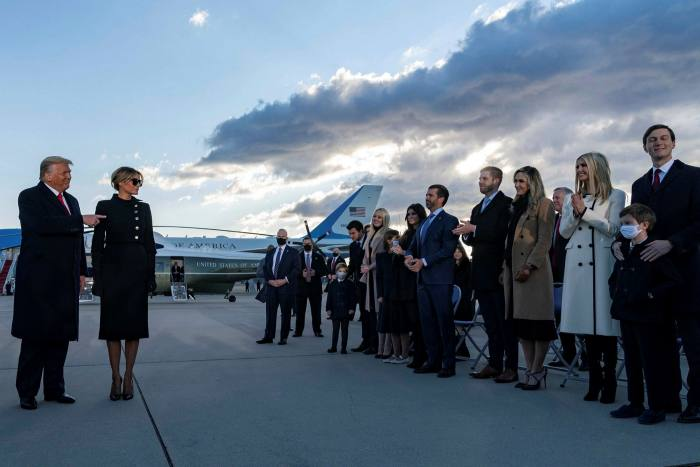 Members of the Trump family line up in front of Donald and Melania Trump on his last day in office. One possibility under examination is whether the former president inflated the value of his properties for some purposes, while minimising them when it came to paying taxes