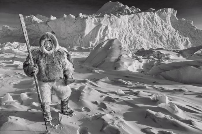 Greenlandic hunter Mads Ole on sea ice, Inglefield fjord, north-west Greenland, in 2019