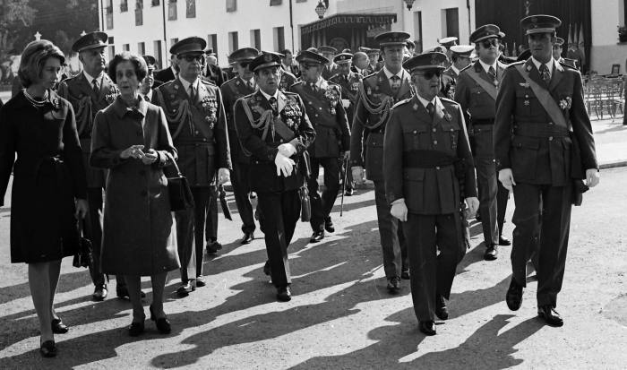 Juan Carlos, far right, walks with Spain's then dictator Francisco Franco in Madrid in 1974
