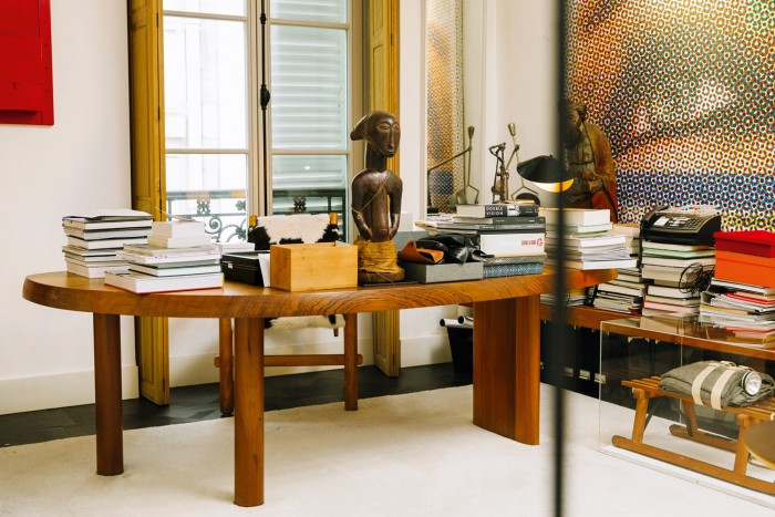 His Charlotte Perriand Free-form table (with a Joseph Beuys Sled to the right)