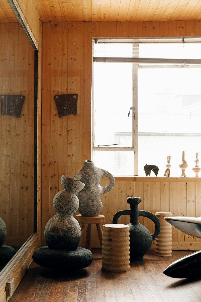 The dance studio showcases Ben Branagan recycled-paper sculptures and Havelock Studio wooden plinths; the window sculptures and wall art are by Joel Tomlin