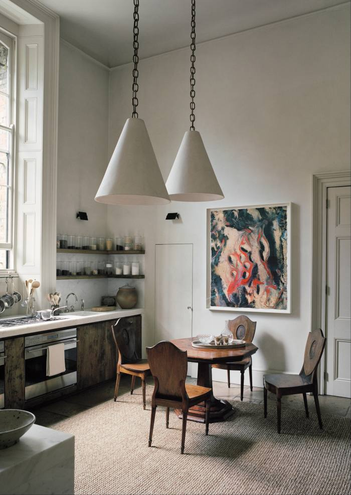 Cone lights by Syrie Maugham and a Ryan Sullivan abstract in the kitchen