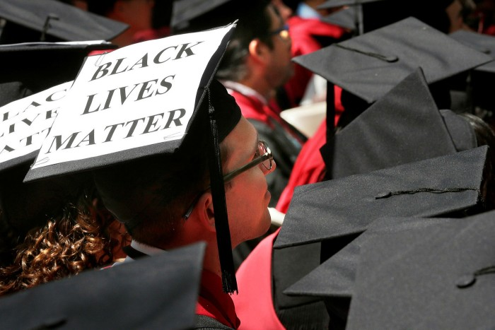 A Harvard student graduates in 2015. Sparked in part by the Black Lives Matter movement, the university's business school has launched a racial equity action plan