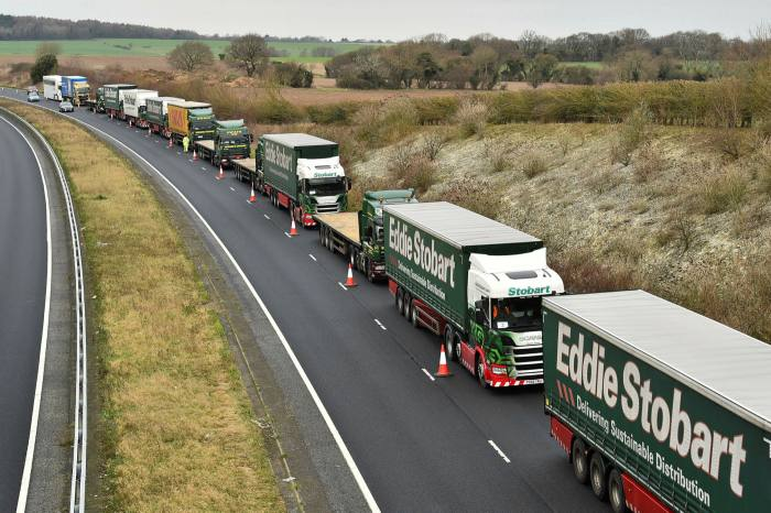 Lorries near Dover take part in a trial to tackle potential post-Brexit traffic queues. Lorry parks and inspection points are being created to facilitate customs controls between Britain and the EU