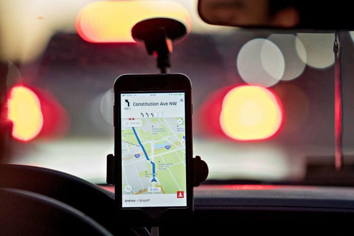 Phone showing Uber app
