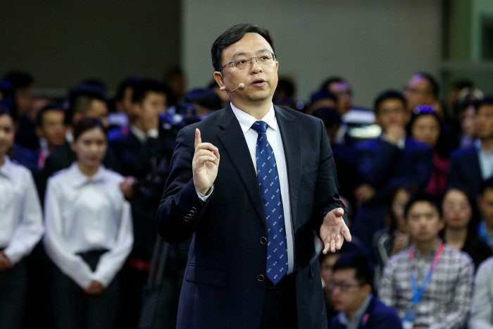 Wang Chuanfu, the Chairman and President of Chinese Automaker BYD delivers a speech during Auto China 2018 motor show in Beijing