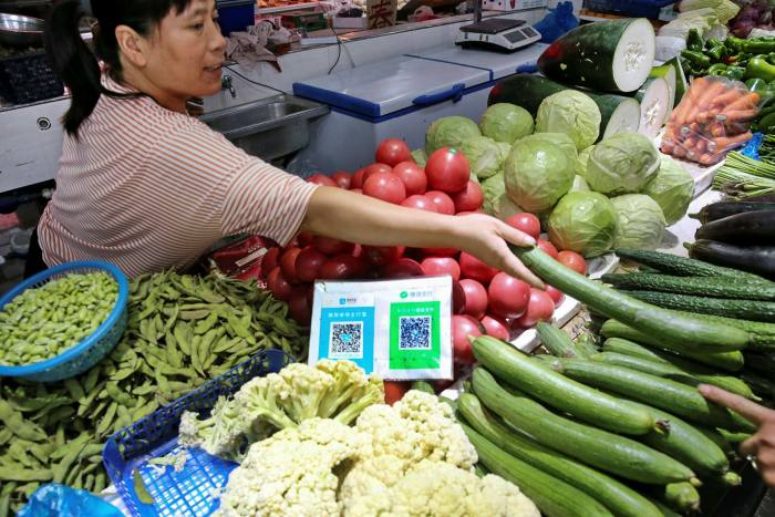 Alipay and WeChat QR codes for online payment are seen at a market in Nantong in China's eastern Jiangsu province