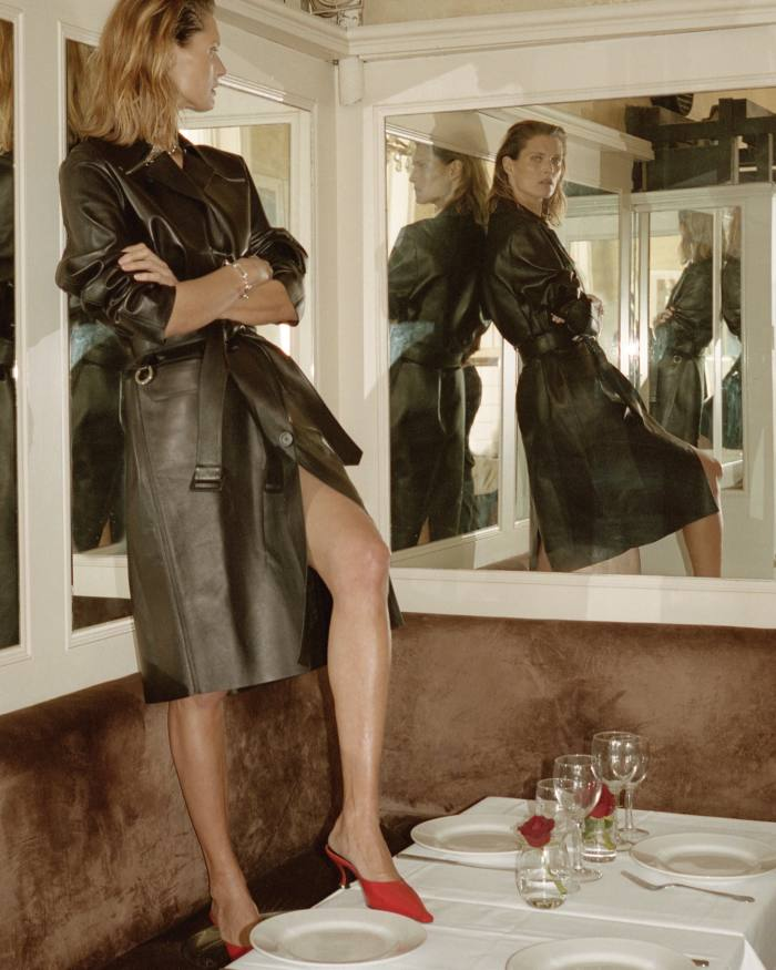 Tod's leather trench coat, £2,900. Kwaidan Editions leather mules, £460. Byredo x Charlotte Chesnais silver Value chain, from £1,450, and matching bracelet, from £780