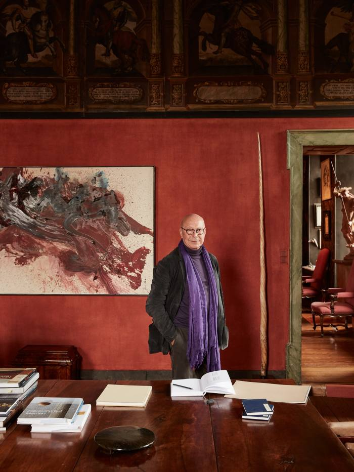 Axel Vervoordt in his study with a Gutai painting