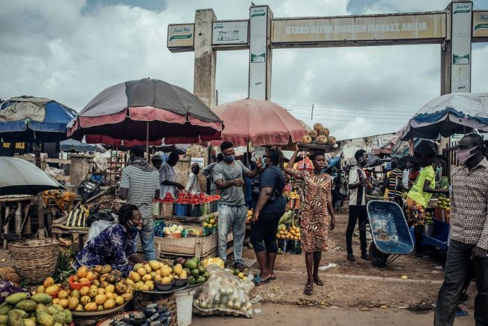A market in Abuja, where a former Nigerian government official says he received a bag with $50,000 in cash from the late P&ID project director Neil Hitchcock