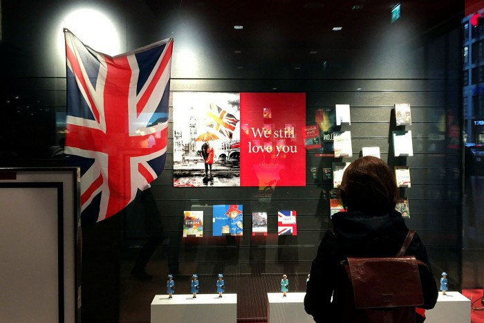 A Berlin bookshop with a Union Jack and a display that reads 'We still love you'