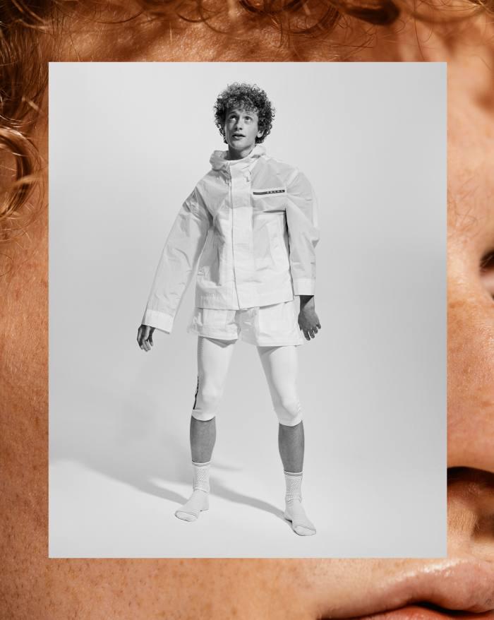 Jack Lovekin wears Prada ripstop jacket, £2,130, ripstop shorts, £790, techno-knit leggings, £605, and techno-knit socks, £160