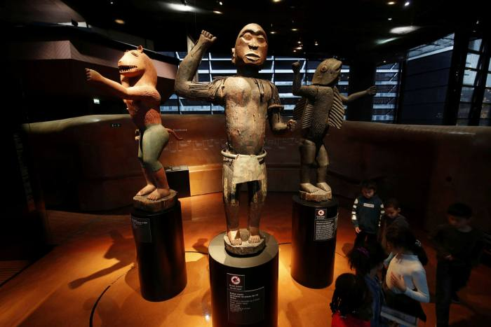 Three statues from Benin on display in Paris. The French National Assembly has passed a law to return 27 works of art to Benin and Senegal within a year
