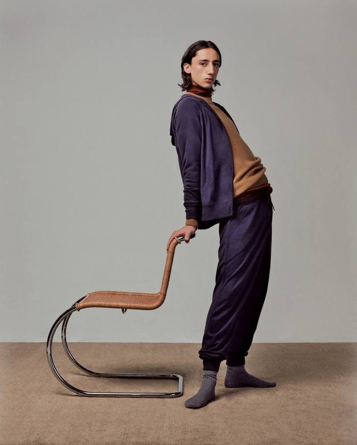 LORO PIANA cashmere/silk Portland bomber, £1,535, matching trousers, £1,255, cashmere Le Mans jumper, £1,445, and Harley cashmere/silk rollneck, £1,350. PANTHERELLA cotton Danvers socks, £14. THONET S533 R chair, £1,258, conranshop.com. THE RUG COMPANY hand-knotted bamboo silk rug, from £1,116