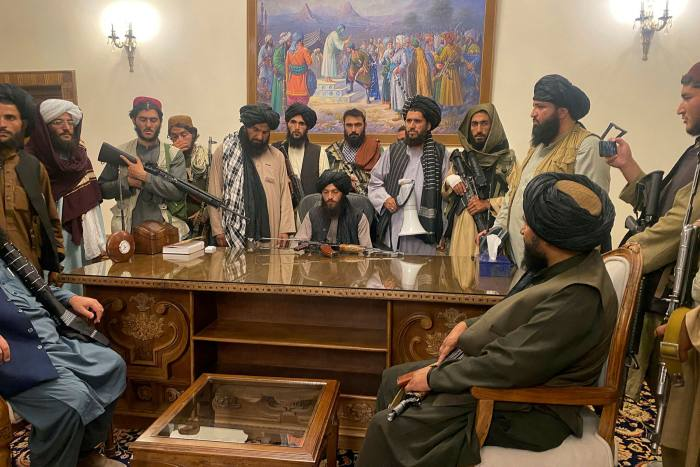 Taliban fighters take control of the Afghan presidential palace on August 15
