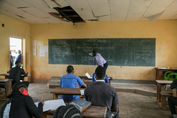 High school students return to class after Covid closures. Pupils who begin learning in local languages may later also have lessons in former colonial tongues