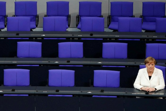 German Chancellor Angela Merkel sits on the government's bench