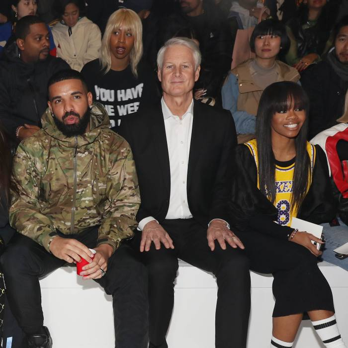 John Donahoe with Rosalia and Drake at a fashion show in 2020