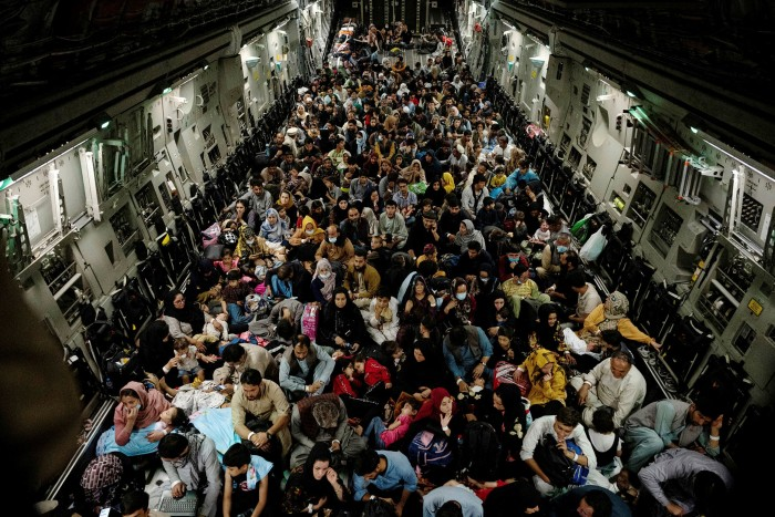 Afghan's crowd into a US transport aircraft at Kabul airport. Western governments were caught off guard by the sheer number of people seeking assistance to escape the Taliban