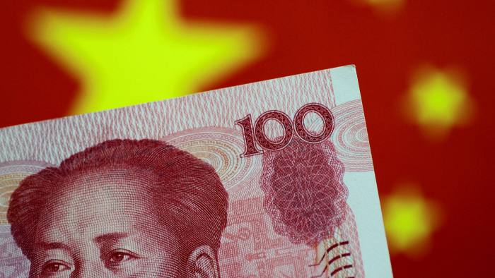 Chinese banknote against backdrop of China's flag