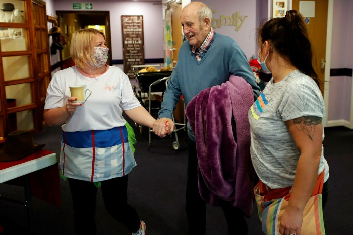 A resident at a Nottinghamshire nursing home is helped by staff