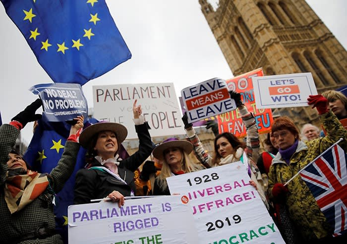 Pro-Brexit demonstrators outside Westminster in London, January 2019. Having delivered the 'pure' Brexit he promised Leave voters, Johnson says he will build a new, agile British economy, focused on AI, robotics and biotech