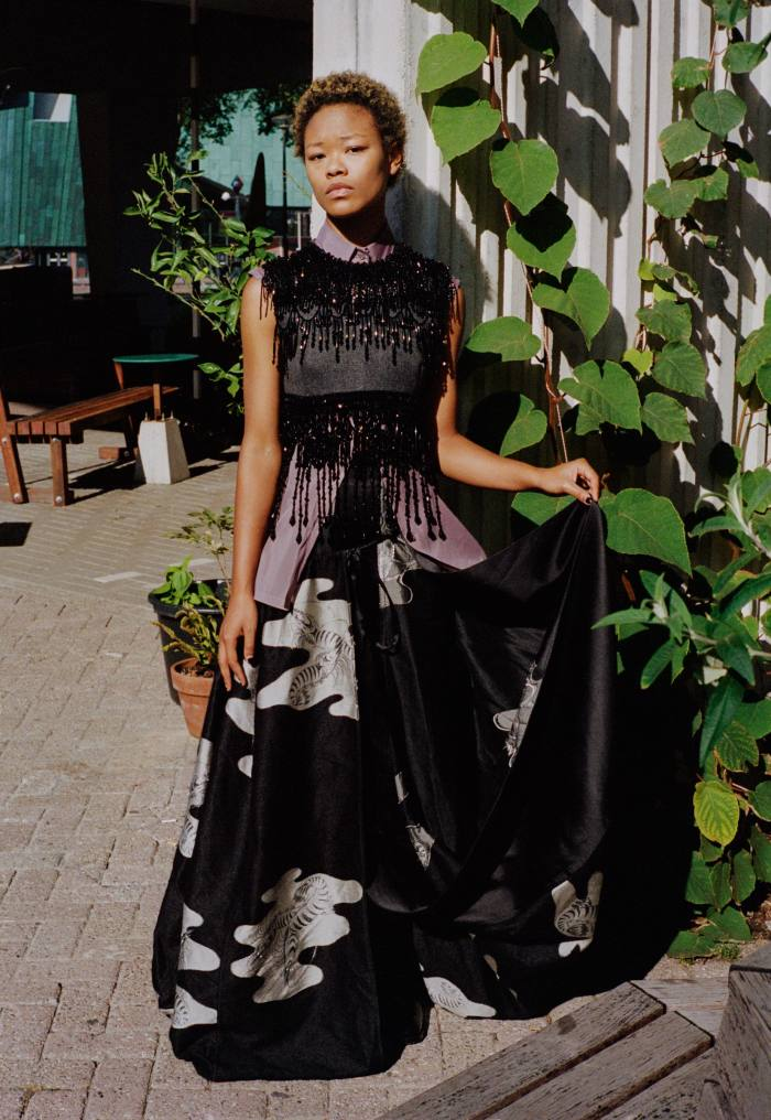 Kaya was born in New York and came toAmsterdam aged seven. Now 18, shehas recently finished high school, sings, plays piano and is currently preparing to go toartschool. Prada wool and bead embroidered top, £4,150, and organza cotton shirt, £605. Loewe wool/silk satin skirt, £5,450